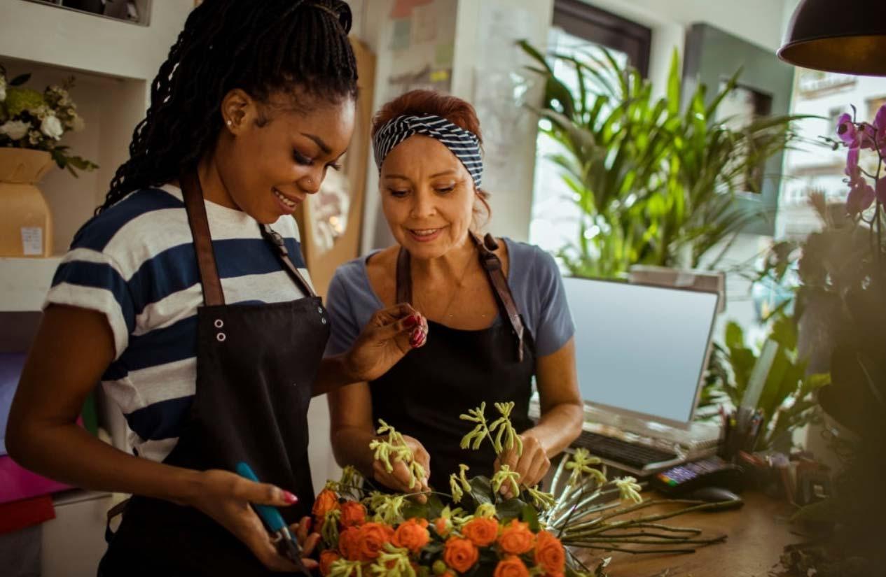 flower shop worker teaching the new employee